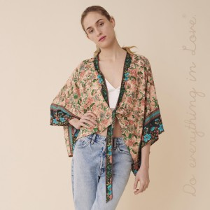 """Do everything in Love brand women's lightweight Peach oriental floral crop kimono with front tie detail.  - One size fits most 0-14 - Approximately 19"""" L - 100% Viscose"""