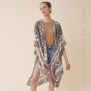 """Do everything in Love Brand Lightweight Snakeskin Stripe Border Kimono.  - One size fits most 0-14 - Approximately 37"""" L - 100% Polyester"""