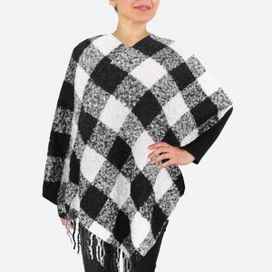 """Buffalo Check Poncho Featuring Fringe Tassel Trim.  - One size fits most 0-14 - Approximately 34"""" L  - 100% Acrylic"""