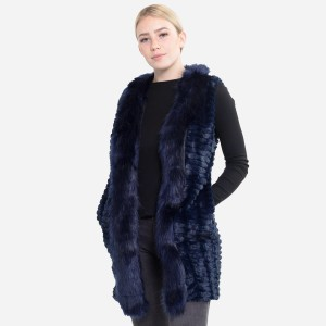 """Faux Fur Vest with Pockets.  - One size fits most 0-14 - Approximately 31"""" L - 100% Polyester"""
