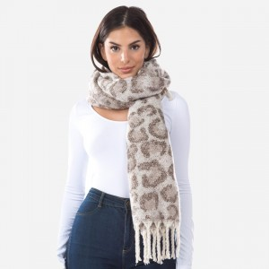 "Fuzzy Knit Leopard Print Oblong Scarf Featuring Tassels.  - Approximately 22""W x 72""L - 100% Polyester"