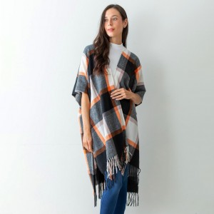 """Women's Black Plaid Knit Ruana Wrap Featuring Tassel Edges.  - One Size Fits Most (Sizes 0-14) - Approximately 32"""" in Length - 100% Polyester"""