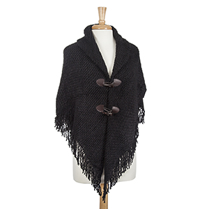 Black poncho with fringe. 100% Acrylic. One size fits most.