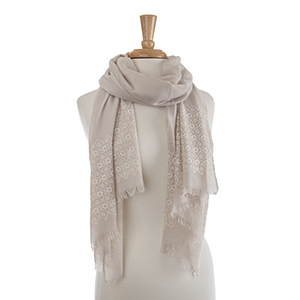 "Lightweight taupe flower embroidery oblong scarf. 30% Cotton and 70% viscose. Approximately 27 1/2"" x 72""."