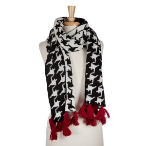 Black and white hounds tooth open scarf with red tassels. Approximately 72 x 20100% acrylic.