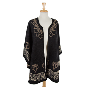 Black cape with a taupe pattern. 100% acrylic. One size fits most.