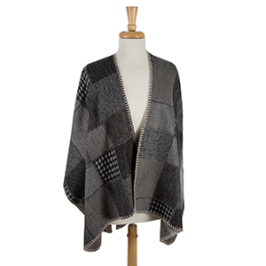 Black and gray printed cape wth beige stitching. 100% acrylic. One size fits most.