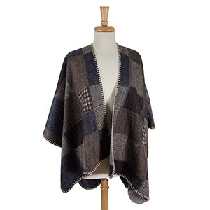 Navy blue and brown printed cape wth beige stitching. 100% acrylic. One size fits most.