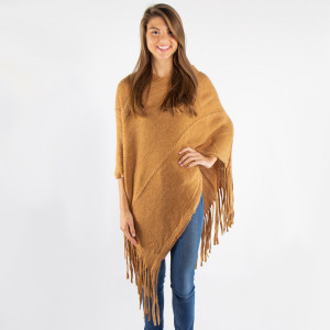 Camel brown knit poncho with tassel twist trim. 100% acrylic. One size fits most.