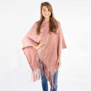 Dusty pink knit poncho with tassel twist trim. 100% acrylic. One size fits most.