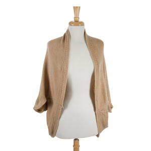 Solid beige cocoon kimono top. 100% acrylic. One size fits most.
