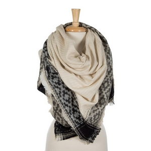 """Black and ivory blanket scarf with frayed edges. 100% acrylic. Measures 56"""" x 56"""" in size."""