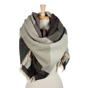 """Gray, beige and taupe printed blanket scarf with frayed edges. 100% acrylic. Measures 56"""" x 56"""" in size."""
