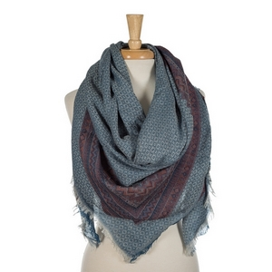 """Blue lightweight blanket scarf. 55% viscose and 45% acrylic. Measures 56"""" x 56"""" in size."""