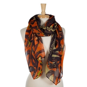 """Navy blue, orange, and yellow abstract printed open scarf. 100% polyester. Measures 70"""" x 42"""" in size."""