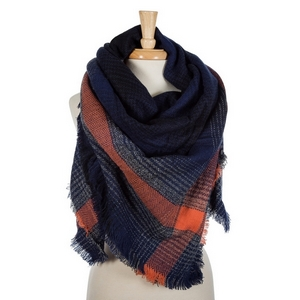 """Navy blue and orange plaid blanket scarf with frayed edges. 100% acrylic. Measures 56"""" x 56"""" in size."""