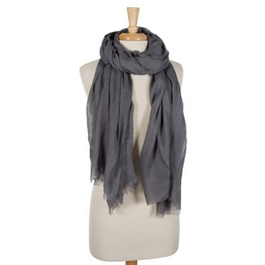 """Charcoal gray lightweight open scarf with frayed edges. 100% cotton. 72"""" x 45"""" in size."""
