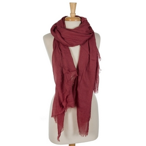 """Burgundy lightweight open scarf with frayed edges. 100% cotton. 72"""" x 45"""" in size."""