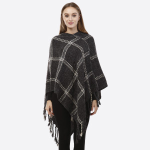 Charcoal gray poncho with a plaid design and tassel accents. 100% acrylic. One size fits most.