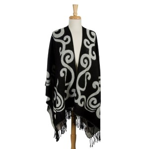 Black and white reversible cape with a swirl pattern and tassels along the bottom hem. 100% acrylic. One size fits most.