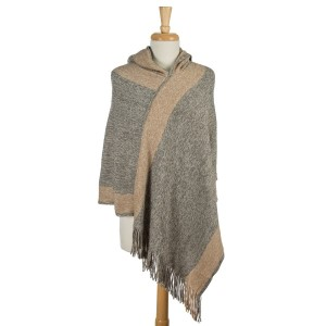 Brown and beige, turtleneck poncho with fringe detailing. 100% acrylic. One size fits most.