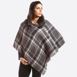 Gray and ivory plaid poncho with a houndstooth pattern on the inside. 100% acrylic. One size fits most.