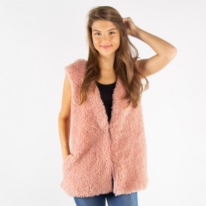 Faux fur sleeveless vest with a sherpa look. 100% acrylic. One size fits most.