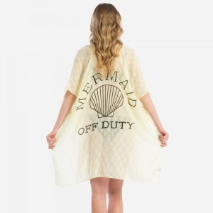 """Lightweight, kimono/swimsuit cover up with """"Mermaid Off Duty"""" on the back. 100% viscose. One size fits most."""