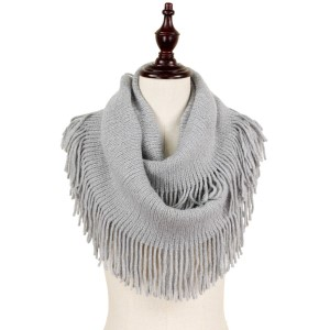 Lurex knit infinity scarf with fringe. 100% acrylic.