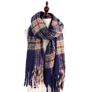 Soft knit plaid scarf with fringe. 50% acrylic and 50% polyester.