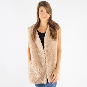 Faux shearing vest with pocket details.  - One size fits most 0-14 - 100% Polyester