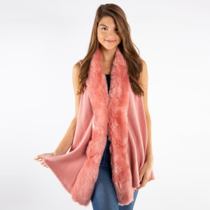 Faux fur trimmed vest. 100% acrylic.   One size fits all.