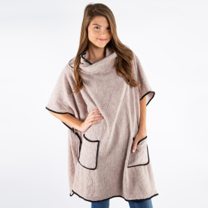 Heavyweight poncho with turtle neck and front pockets. 100% Polyester.  One size fits most.