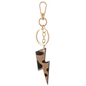 """Genuine Leather Cow Print Lightning Bolt Keychain Bag/Purse Charm.  - Keyring to hold your Keys - Clip to clip onto your Bag/Purse or Backpack - Double Sided Animal Print - Lightning Bolt Approximately 2.75"""" - (Approx) 5"""" Overall"""