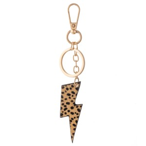 """Genuine Leather Cheetah Print Lightning Bolt Keychain Bag/Purse Charm.  - Keyring to hold your Keys - Clip to clip onto your Bag/Purse or Backpack - Double Sided Animal Print - Lightning Bolt Approximately 2.75"""" - (Approx) 5"""" Overall"""