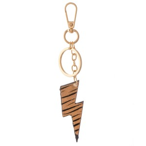 """Genuine Leather Zebra Print Lightning Bolt Keychain Bag/Purse Charm.  - Keyring to hold your Keys - Clip to clip onto your Bag/Purse or Backpack - Double Sided Animal Print - Lightning Bolt Approximately 2.75"""" - (Approx) 5"""" Overall"""