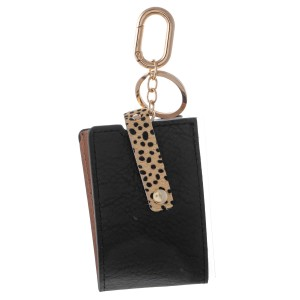 "Genuine Leather Mask Keeper Keychain Holder Featuring Animal Print Detail.  - Keyring to hold your Keys - Detachable Clip for Clipping onto Purse or Bag - Easy to Clean - Quick & Easy Way to Store Your Mask - Lay Mask Flat, Fold Long Ways, Fold in Half and Button - Approximately 3"" x 2.5"""