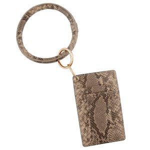 """Slim minimalist faux leather snakeskin card keyring holder.  - 4 functional pockets - Approximately 3"""" W x 4.5"""" T - Ring 3.5"""" in diameter - 100% PU"""