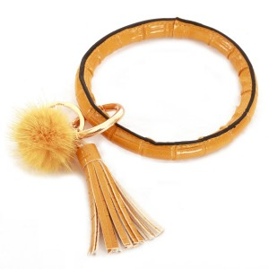 """Faux Leather Pom Tassel Key Ring Bangle Keychain Holder.  - Hold Keys while wearing on wrist or bag - Approximately 4"""" in diameter"""
