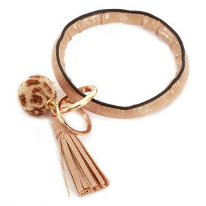 """Faux Leather Leopard Pom Tassel Key Ring Bangle Keychain Holder.  - Hold Keys while wearing on wrist or bag - Approximately 4"""" in diameter"""