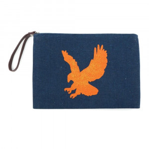 "Auburn clutch featuring a wristlet, lined inside with pocket and zipper closure. Approximately 7"" x 10"" in size.  - Composition: 60% Cotton, 40% Polyester"
