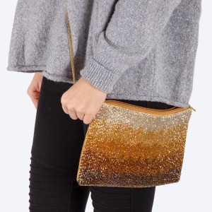 """High quality seed beaded ombre handbag.  - Zipper closure - One inside open pocket - Inside lining 100% Cotton - Approximately 10.5"""" W x 7"""" T - Strap approximately 52"""" L - Approximately 62"""" L overall - 40% Seed beads, 40% Cotton Canvas, 20% Metal"""
