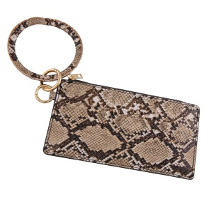 """Faux leather snakeskin keyring wallet wristlet.  - Open lined inside  - No pockets - Zipper closure - Detachable  - Ring approximately 4"""" in diameter - Wallet approximately 8"""" L x 4"""" T - 100% PU"""