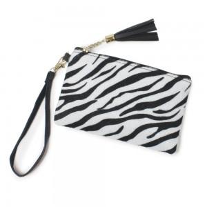 "Zebra Print Tassel Wristlet.  - Zipper Closure - Open Lined Inside  - No Pockets - Detachable Wristlet - Approximately 7"" x  5""  - 100% Polyester"