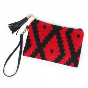 "Aztec Print Tassel Wristlet.  - Zipper Closure - Open Lined Inside  - No Pockets - Detachable Wristlet - Approximately 7"" x  5""  - 100% Polyester"