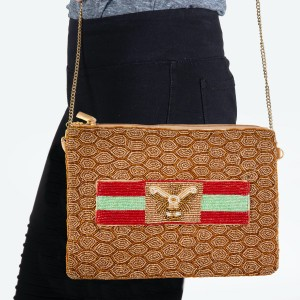 """Designer Inspired Gold Seed Beaded Canvas Crossbody Handbag Featuring BEE Stipe Detail.  - Zipper Closure - One Inside Pocket - Spot Clean Only - Chain Link Strap 21"""" L - Approximately 9"""" W x 7"""" T - 100% Polyester"""