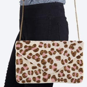 """Ivory Pink Leopard Print Seed Beaded Canvas Crossbody Clutch.  - Fold Over Flap Button Closure - One Inside Pocket - Sport Clean Only - Chain Link Strap 21"""" L - Approximately 10"""" W x 6.5"""" T - 100% Cotton"""