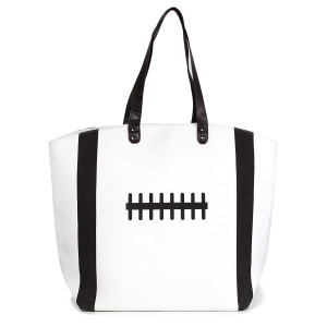 """Football tote bag perfect for tailgating and monogramming. This bag features a snap closure, lined interior and interior pockets. 16"""" x 19"""" in size with a 10"""" handle drop. 80% cotton and 20% polyester."""