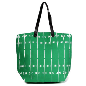 """Football field tote bag perfect for tailgating and monogramming. This bag features a snap closure, lined interior and interior pockets. 16"""" x 19"""" in size with a 10"""" handle drop. 80% cotton and 20% polyester."""
