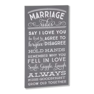 """Decorate your home with this """"Marriage Rules"""" wrapped canvas wall art that includes a metal hanger on the back of the frame for easy hanging and measures 10 x 19 x 1."""